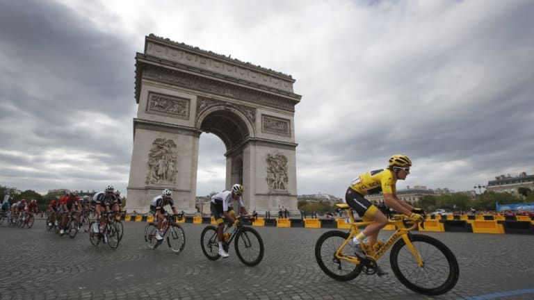 Yellow jersey Geraint Thomas, riding for Team Sky, loops around the Arc de Triomphe en route to victory in the 2018 Tour de France on Sunday.