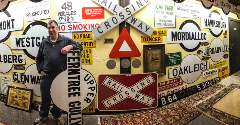 Signs, signs, everywhere a sign: Graham Dann with some of the railway signs he is selling on Sunday.