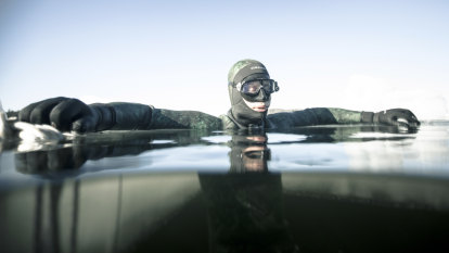 In darkness, under the Arctic ice, Aussie diver chases a cool first