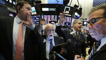 The tide's gone out: New York Stock Exchange Floor Governor Brendan Connolly with traders on the floor of the NYSE amid this week's market carnage.