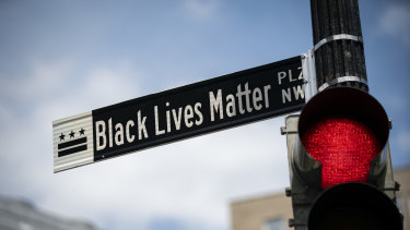 A newly installed street sign designates Black Lives Matter Plaza NW in Washington, DC.