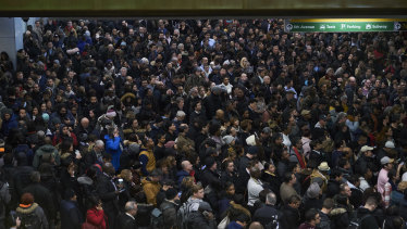 Commuters wait in long lines at the Port Authority Bus Terminal in Manhattan.