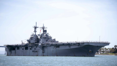 The US Navy claims it shot down an Iranian drone after it approached the USS Boxer, pictured, in the Persian Gulf.