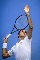 Federer fires down a serve.