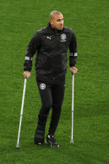 Patrick Kisnorbo on crutches earlier this month.