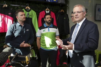 Canberra A-League bid leader Michael Caggiano (middle) with Prime Minister Scott Morrison back in 2018.