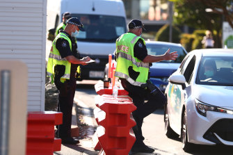 Queensland Police stop cars at the Griffith Street checkpoint in Coolangatta on August 25.