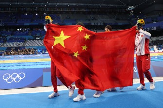 Chinese gold medallists Junxuan Yang, Yufei Zhang, Bingjie Li and Muhan Tang after the medal ceremony for the women's 4 x 200m freestyle relay on Thursday.