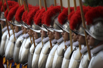 Swiss Guard recruits stands at attention during the swearing-in ceremony at the Vatican.