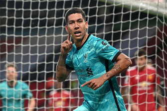 Roberto Firmino celebrates the first of his two goals in Liverpool's 4-2 Premier League win over Manchester United.