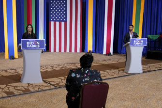 Actress Eva Longoria, left, and performer Ricky Martin speak in support of Democratic presidential candidate Joe Biden in Kissimmee, Florida.