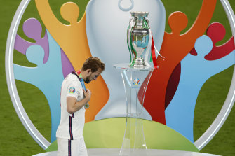 So close, but so far: Harry Kane walks past the trophy after losing the Euro 2020 final on penalties.