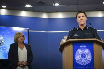 Police Minister Lisa Neville watches as Deputy Commissioner Shane Patton addresses the media on Tuesday.