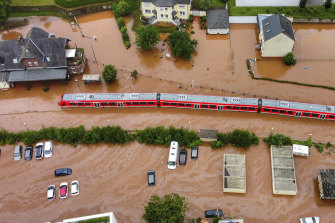 A train sits in floodwaters in Kordel, Germany.
