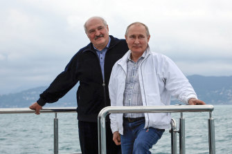 Russian President Vladimir Putin, right, and Belarusian President Alexander Lukashenko pose for a photo standing on the boat during their meeting in the Black Sea resort of Sochi, in Russia, Saturday, May 29, 2021.