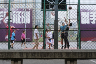 Chinese basketball fans playing at Dongdan Basketball Park in central Beijing.