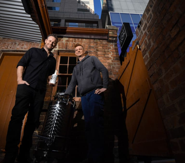 Spirited: Brothers Brad (left) and Jarrod Wilson run a new gin distillery and bar at 17 Casselden Place, an early Melbourne brothel and sly grog shop now ringed by skyscrapers.