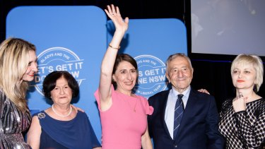 Premier Gladys Berejiklian, flanked by her family, arrives at the Sofitel Wentworth in Sydney.