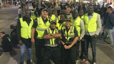 Inspector Stephen Mutton, second from left, at one of the patrols he organised with South Sudanese leaders at large community events, including Moomba.