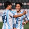 Ulsan Hyudnai's Park Jeong-in (right) enjoys a goal against Shanghai Shenhua with teammate Kim Sung-joon.