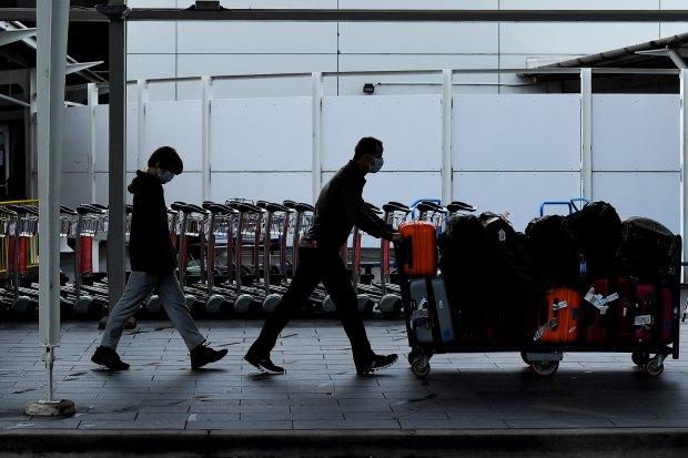 Passengers arrive at Sydney International Airport.