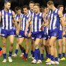 MELBOURNE, AUSTRALIA - MAY 08: The Kangaroos walk off after they were defeated by the Magpies during the round eight AFL match between the North Melbourne Kangaroos and the Collingwood Magpies at Marvel Stadium on May 08, 2021 in Melbourne, Australia. (Photo by Robert Cianflone/Getty Images)