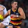 Taylor Walker of the Crows and Alex Pearce of the Dockers