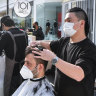 Victorians rush for hair cuts, hopes grow for good Christmas for retailers