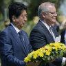 Japan PM Shinzo Abe lays wreath at Australian war site in symbolic gesture