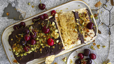 Pistachio semifreddo with chocolate and cherries.