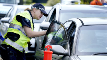 Police stop motorists at a checkpoint at Coolangatta.