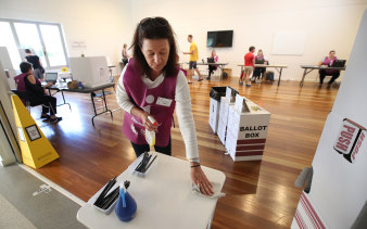 A polling booth official at work during the COVID-19 pandemic in Brisbane.