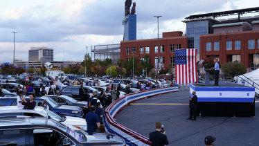 Former president Barack Obama campaigns for Joe Biden at a drive-in rally in Philadelphia.