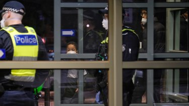 Police at the entrance of the Flemington public housing towers on Saturday night.
