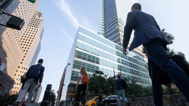 Office workers in New York: Wall Street banks have been at the forefront of the push to restock America's skyscrapers with workers.