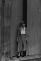 """""""Mrs. Elise Lund outside the Garrison Church ... she is its oldest attending parishioner. March 31, 1960."""""""