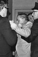 """Fiercest struggle"" ...the fracas spills into the foyer."