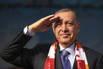 Turkish President Recep Tayyip Erdogan gives a military salute toward his supporters during a rally in Kayseri, Turkey on Saturday.
