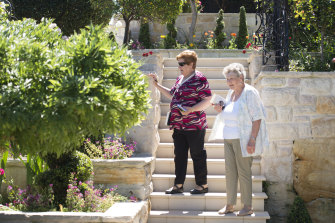 Judges Jeanette Chown,  right, and Cecily Rogers, left, visited Donald Pickens' home at Tennyson Point to judge the finalists in the first Sydney Spring Garden Competition  in 40 years.