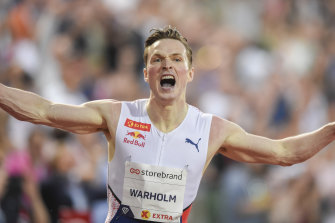 Karsten Warholm celebrates after breaking an almost-three decade-old world record at the Diamond League meet in Oslo.
