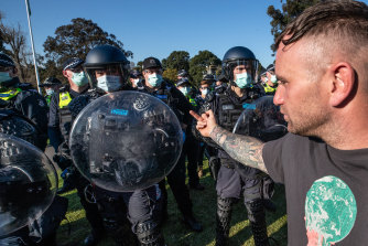 A protester confronts police.