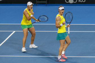 Ashleigh Barty, left, and Sam Stosur, right, celebrate at April's Fed Cup world group semi-final against Belarus.