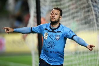 Adam Le Fondre celebrates one of his three goals for Sydney FC against Brisbane.