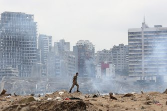 A soldier walks amid the devastation of the August 4 blast in the port of Beirut.