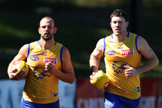 Hitting the track: Eagles Will Schofield (left) and Jeremy McGovern.