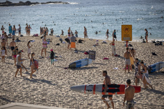 Crowds flocked to Coogee Beach on Saturday morning, prior to the beach being closed at 9am.