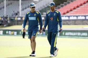 No hard feelings: Justin Langer and Usman Khawaja.