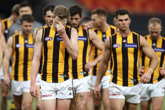 The Hawks leave the field looking dejected after a round five loss to GWS.