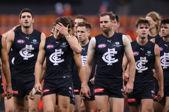 Blues players look dejected after losing to the Giants.