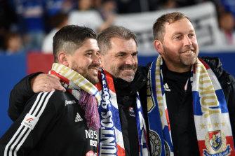 Arthur Papas, left, celebrates Yokohama F. Marinos' title win in 2019 with Ange Postecoglou and Peter Cklamovski.